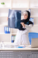 Young doctor in hijab working in the clinic