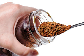 glass jar with instant coffee and spoon isolated
