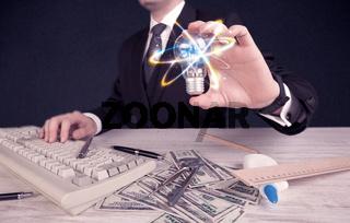 businessman holding a colorful light bulb