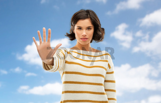 young woman making stopping gesture