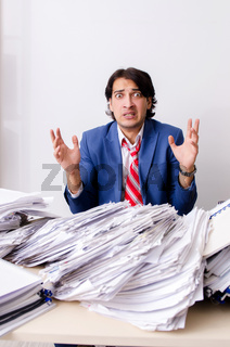 Young businessman employee unhappy with excessive work