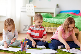 happy kids drawing at home