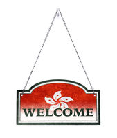 Hong Kong welcomes you! Old metal sign isolated
