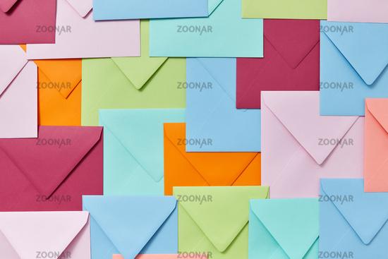 Background of colorful correspondence craft envelopes.