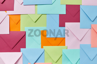 Background of colorful correspondence craft envelopes.