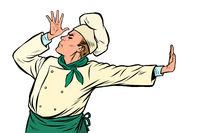 Caucasian cook chef, gesture of shame. denial no