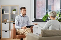 psychologist listening to senior woman patient