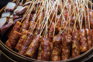 Sausages skewers with raw meat in a plate
