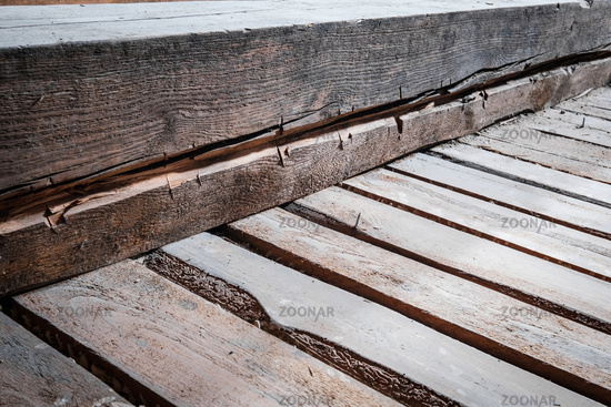old wooden floor beam and plank construction background  in attic loft -