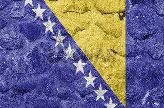 Bosnien und Herzegowina Flagge auf einer Steinmauer