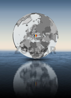 Romania on globe above water