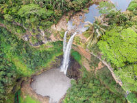 Aerial top view perspective of Chamarel Waterfall in the tropical island jungle of Mauritius.