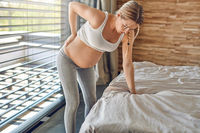 Heavily pregnant woman suffering with back ache