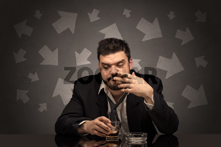 Drunk man sitting at table with arrows around