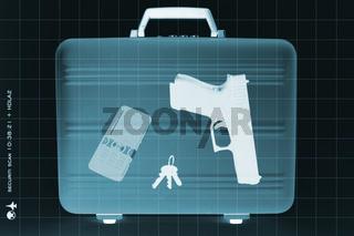 Röntgenbild eines Koffers mit einer Waffe