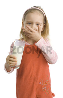 Girl is wiping off milky moustache