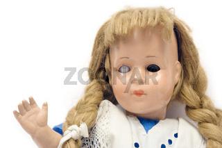 Winkende Puppe