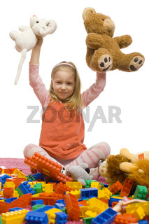 Girl in the middle of toy-mess