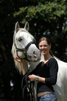 Rider with white grey horse
