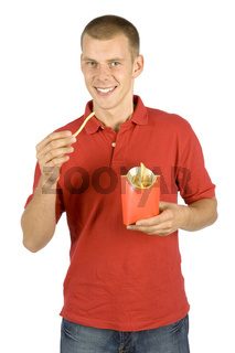 man eats French fries