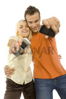 young couple with mobiles