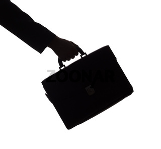 silhouette of man's hand with suitcase