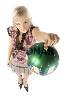 headshot of young blonde woman with christmas ball