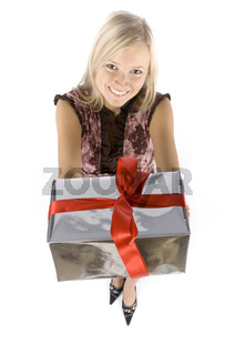 headshot of young blonde woman with gift