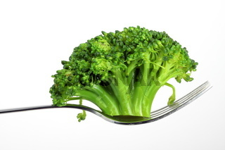 broccoli on a fork over white background