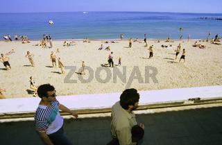 Ukraine, Black Sea, two men walking by beach, elevated view