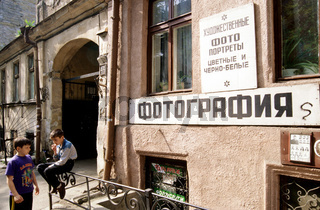 Ukraine, Odessa, two boys (12-13) in front of dilapidated building