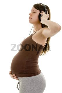 Schwangere hört Musik