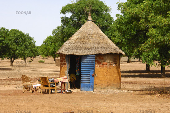 African round hut with thatched roof