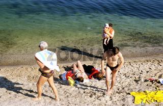 Ukraine, Black Sea, family at beach, elevated view