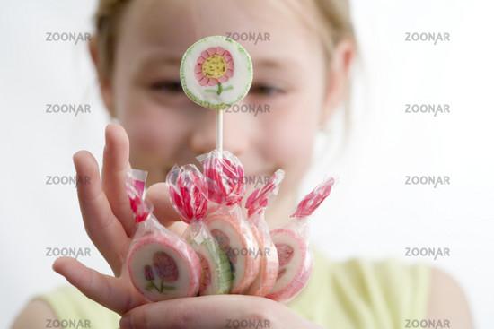 Little girl having a lollipop