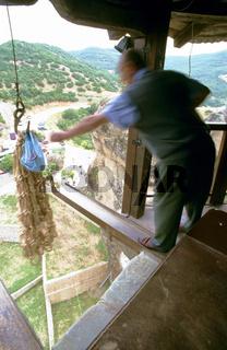 Man operating lift, Thessaly, Meteora, Greece