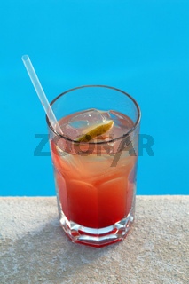 COCKTAIL STANDS ON EDGE OF POOL