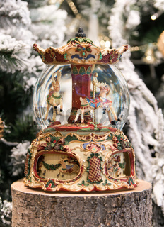 Christmas decoration carousel horses, Christmas presents on wooden table.