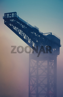 Industrial Crane At Sunrise In The Fog