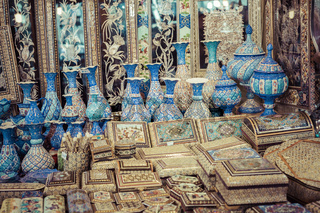 ISFAHAN, IRAN - OCTOBER 06, 2016: Traditional iranian market (Bazaar) metal souvenires, lamps.