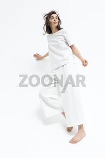 Girl posing in motion in studio