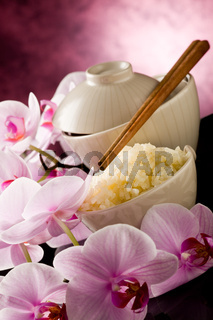 Asian rice dish with orchid flowers