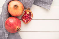 Pomegranates over grunge wooden background