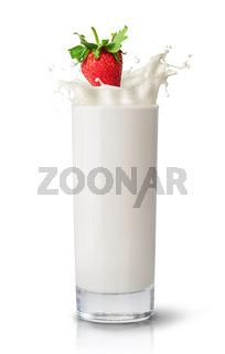 Strawberry falling into milk