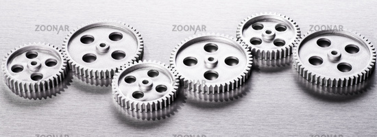 Silver gears in a row