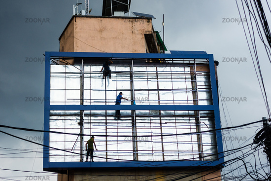 Men working on billboard