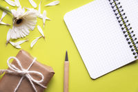 Notebook with broken  flower and gift