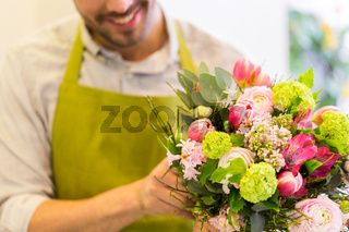 close up of florist man with bunch at flower shop