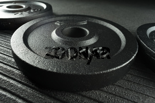 Dumbbell weight plates on a fitness studio / weight training gym floor