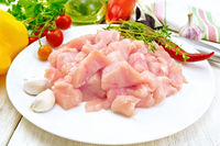 Chicken breast raw sliced in plate on light board